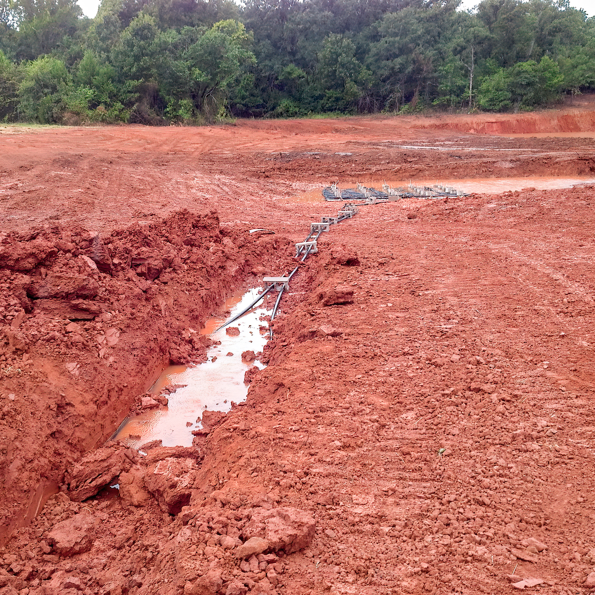 Geothermal Ground Loop New Installation Outside Home.